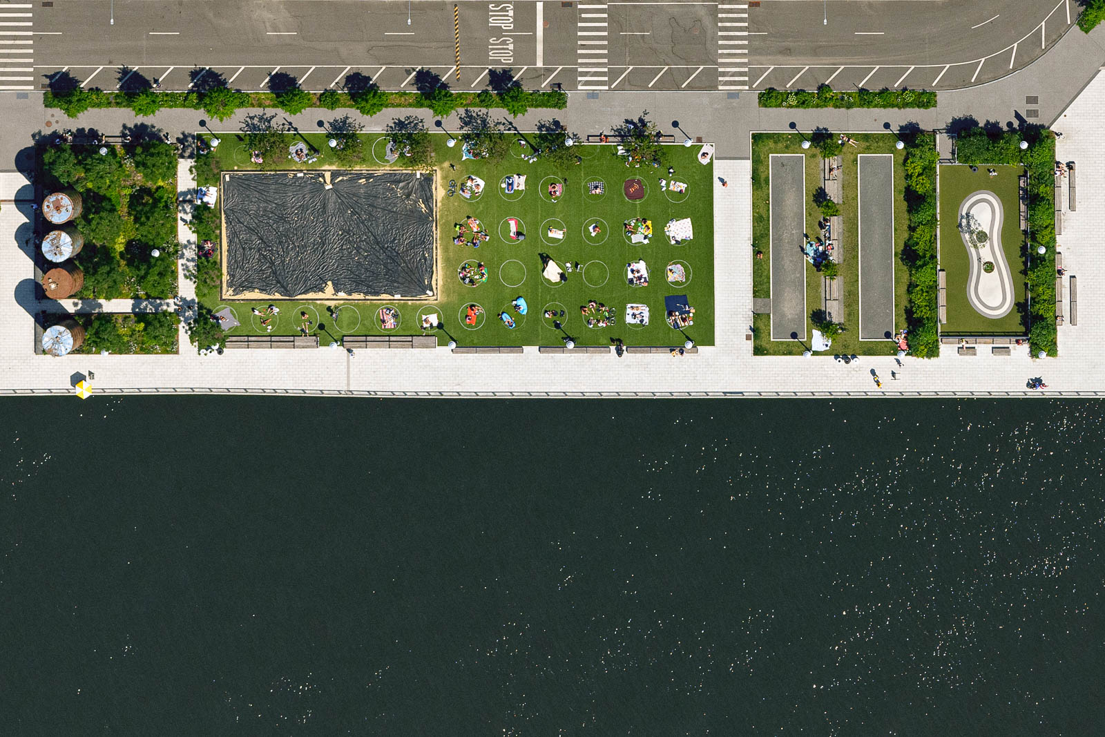 Brooklyn's Domino Park visitors adhere to social distancing guidelines while enjoying beautiful Sunday afternoon (June 2020)