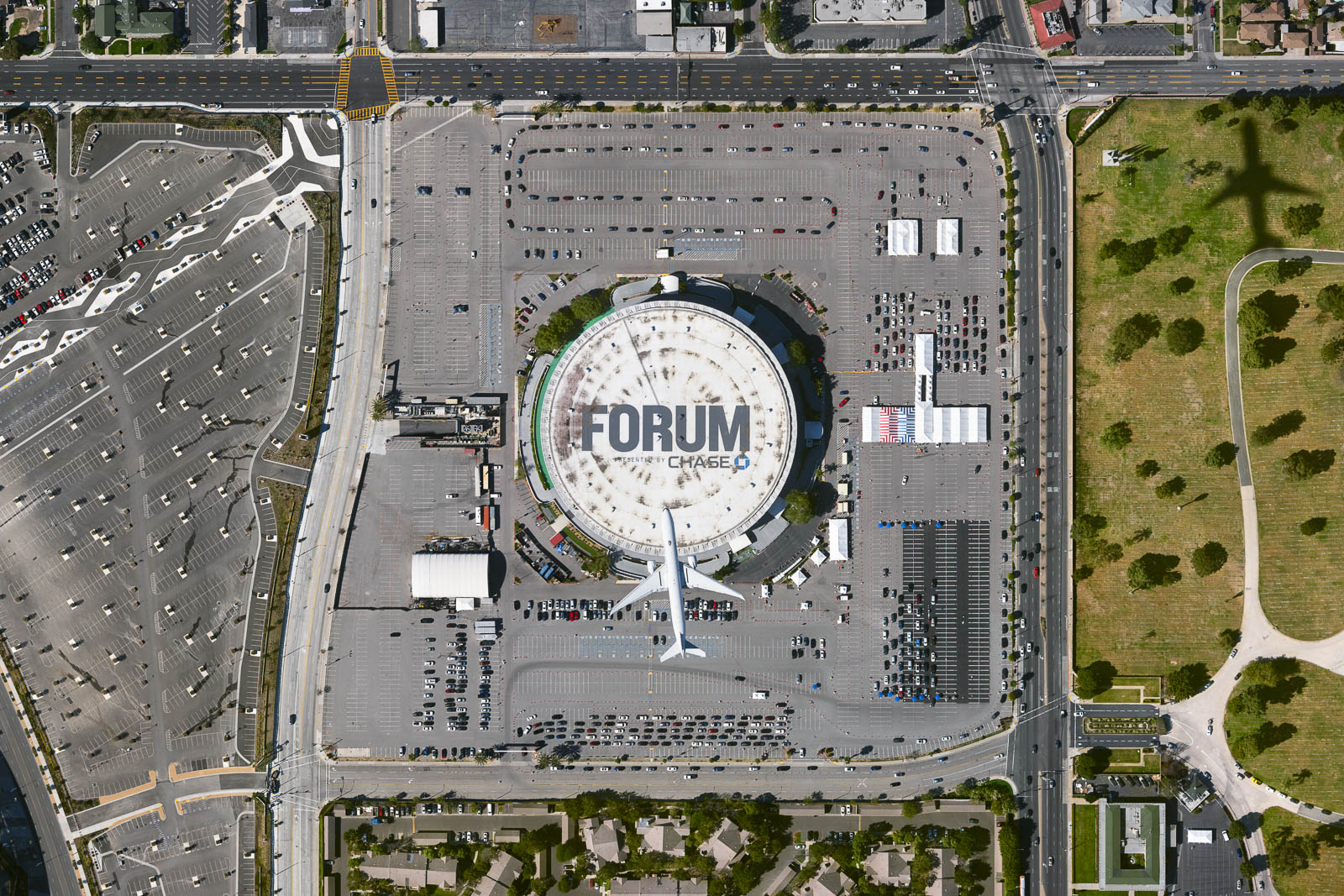 China Airlines jet flies over LA Forum set up as vaccination supersite